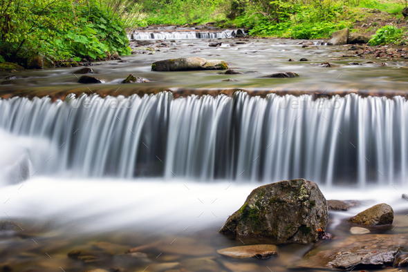 Small stream waterfall on spring forest - Stock Photo - Images