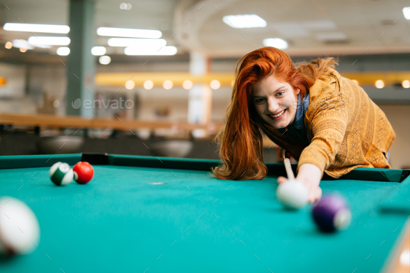 Beautiful woman playing snooker - Stock Photo - Images