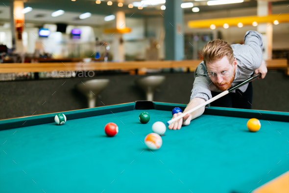 Handsome man aiming at ball - Stock Photo - Images