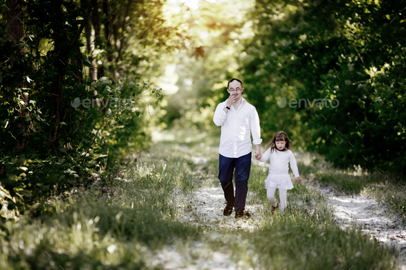 People with down sydrome walking in forest - Stock Photo - Images