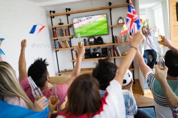 Group of multi-ethnic people celebrating football game - Stock Photo - Images