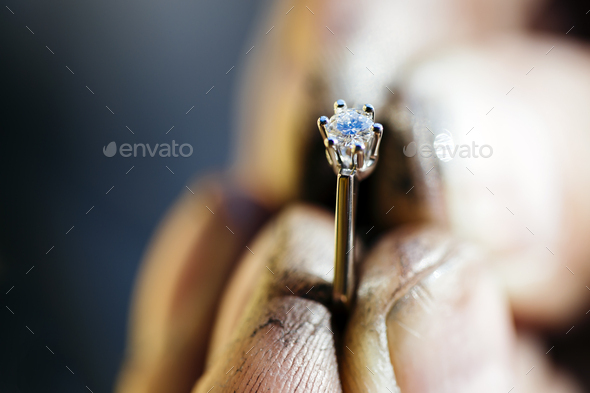 Ring held by jeweler after polishing - Stock Photo - Images