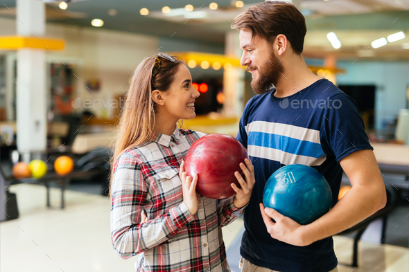 Cheerful friends bowling together and having fun - Stock Photo - Images