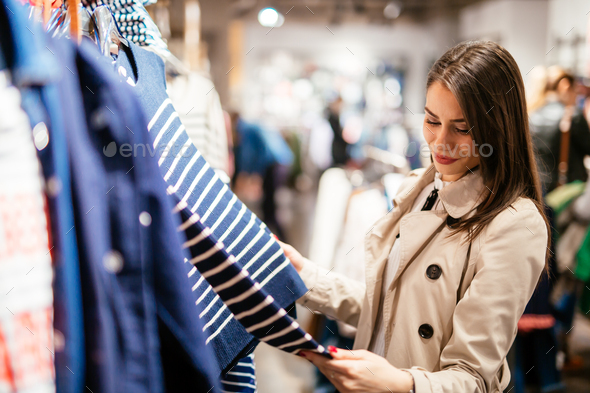 Beautiful brunette buying clothes - Stock Photo - Images