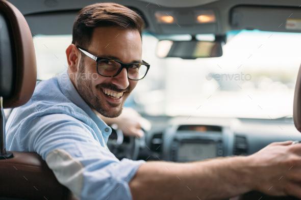 Portrait of a businessman driving car - Stock Photo - Images