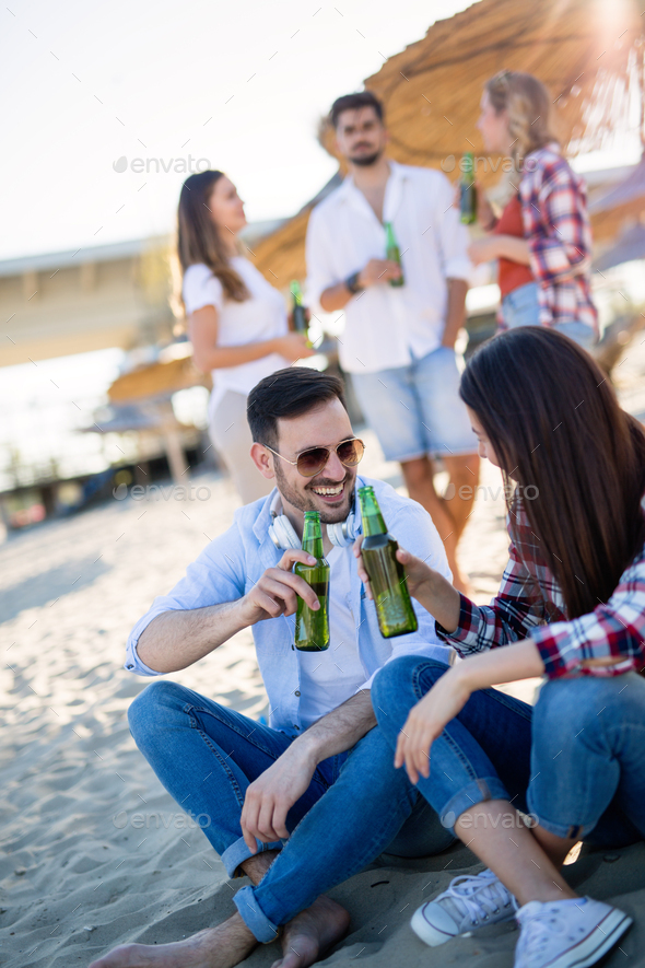 Group of happy young people enjoying summer vacation - Stock Photo - Images