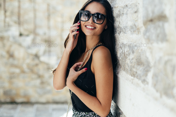 Beautiful woman using phone - Stock Photo - Images