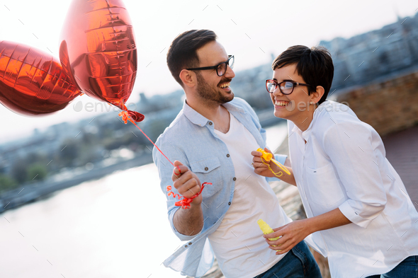 Couple in love dating and smiling outdoor - Stock Photo - Images