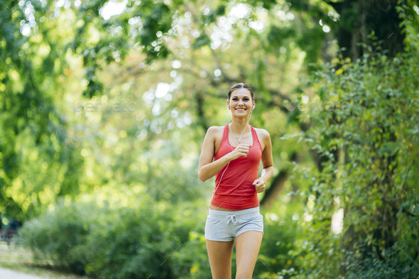Young beautiful athlete jogging in park - Stock Photo - Images
