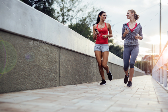 Two women exercising by jogging - Stock Photo - Images