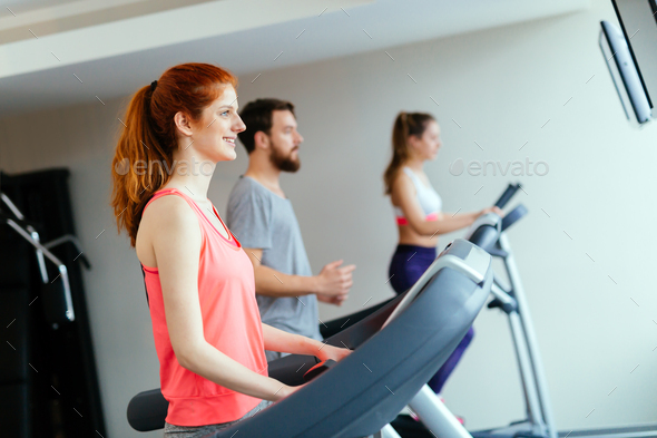 People traning in gym on various machines - Stock Photo - Images