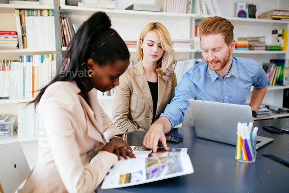 Designers working as a team in office - Stock Photo - Images