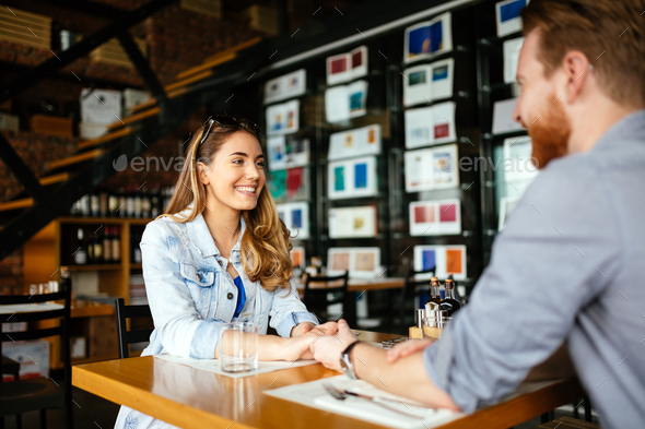 Couple dating in restaurant - Stock Photo - Images