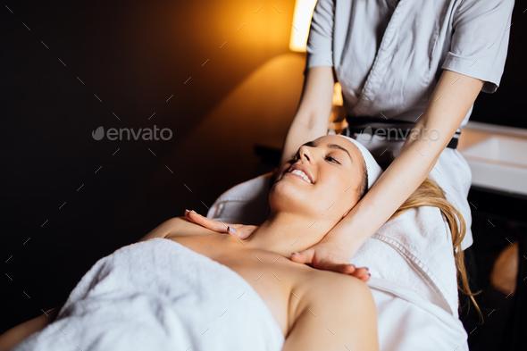 Beautiful woman enjoying massage - Stock Photo - Images