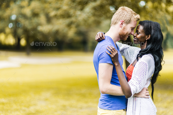 Couple in love hugging and kissing peacfully outdoors - Stock Photo - Images