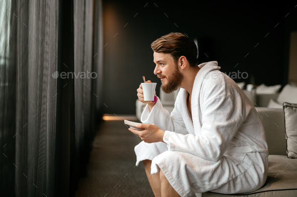 Male relaxing while drinking tea - Stock Photo - Images