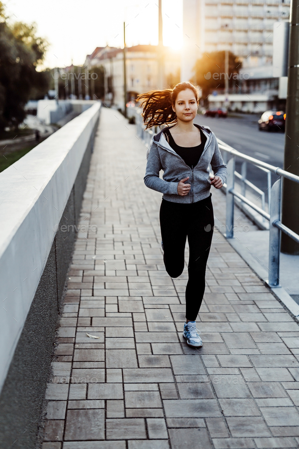 Woman running in city - Stock Photo - Images