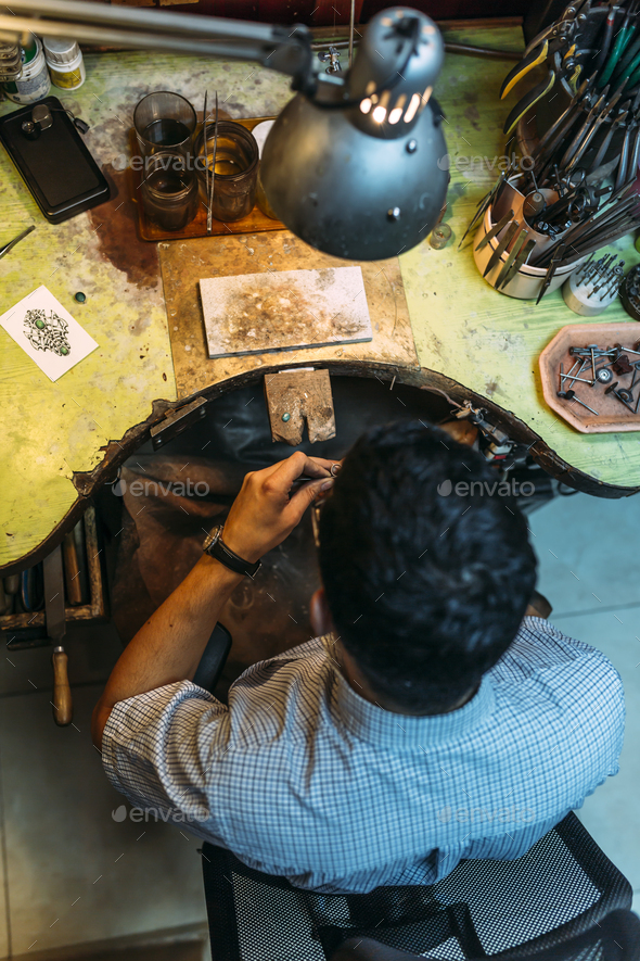Craftsman working on workbench - Stock Photo - Images