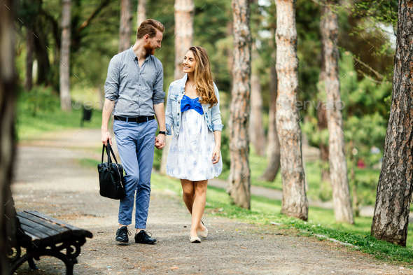 Beautiful couple taking a walk in nature - Stock Photo - Images