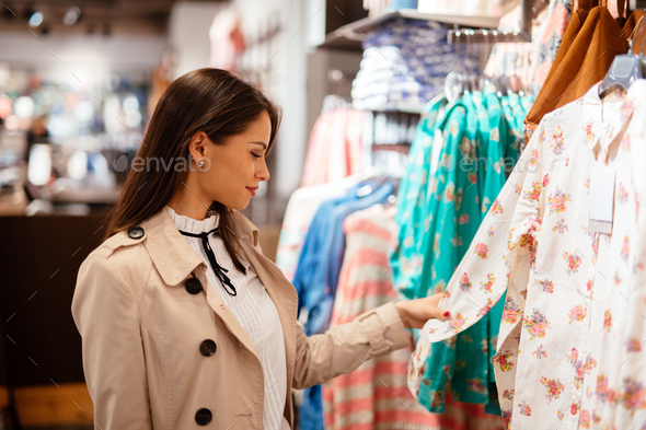Beautiful woman buying clothes - Stock Photo - Images