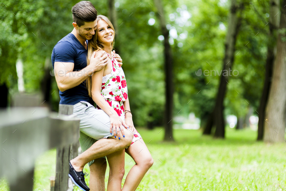 Happy couple loving each other outdoors - Stock Photo - Images