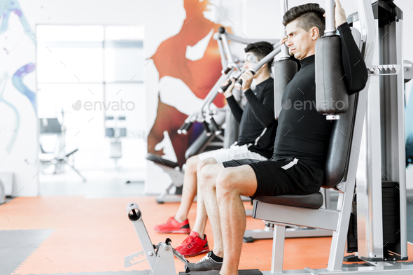 Young handsome men working out in a gym - Stock Photo - Images