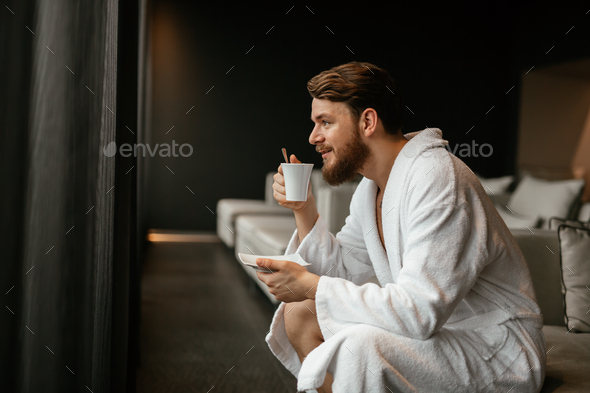 Handsome man relaxing drinking tea - Stock Photo - Images