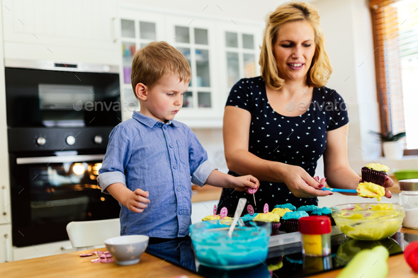 Child helping mother bake cookies - Stock Photo - Images