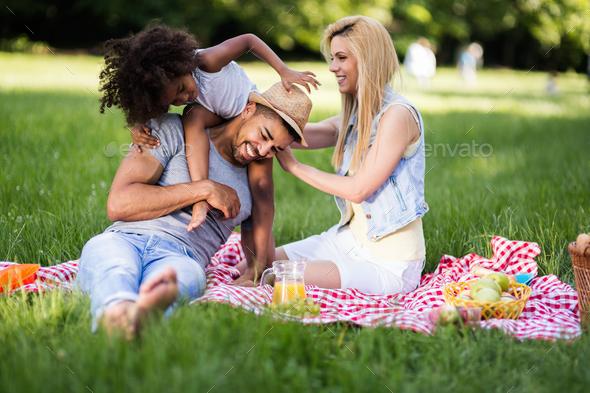 Happy family enjoying picnic - Stock Photo - Images