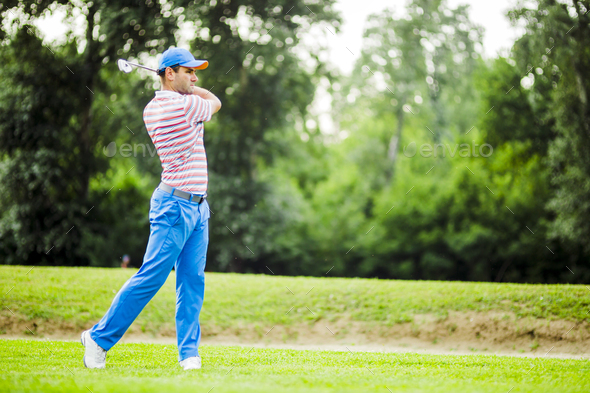 Golfer practicing and concentrating before and after shot - Stock Photo - Images