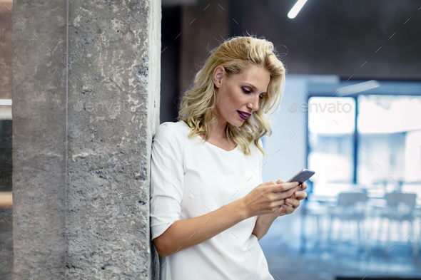 Beautiful woman using mobile phone - Stock Photo - Images