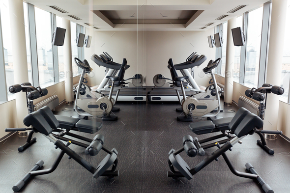 Equipped gym overlooking the city - Stock Photo - Images
