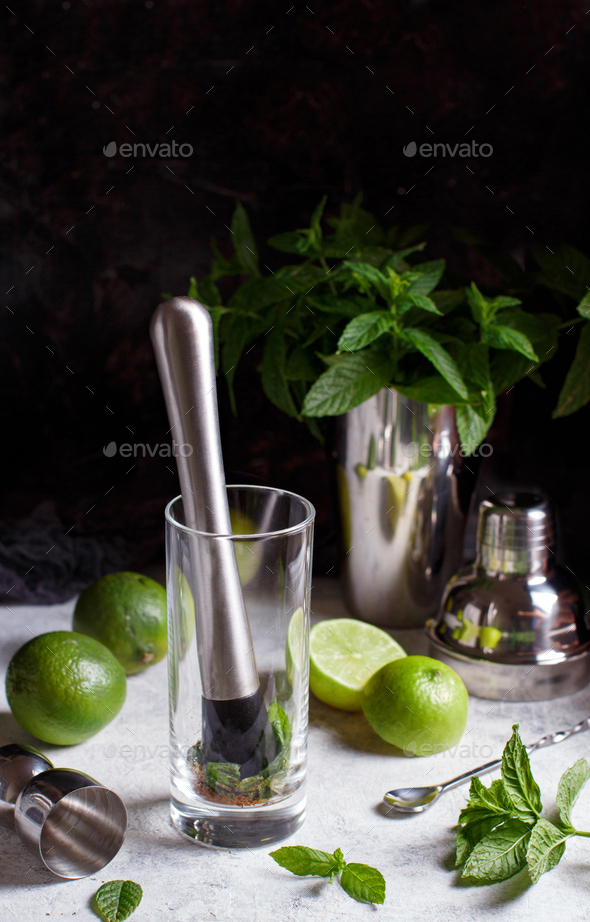 Mojito cocktail making with barmen tools - Stock Photo - Images
