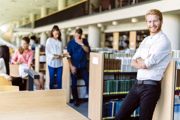 Group of young people educating themselves in a library - Stock Photo - Images