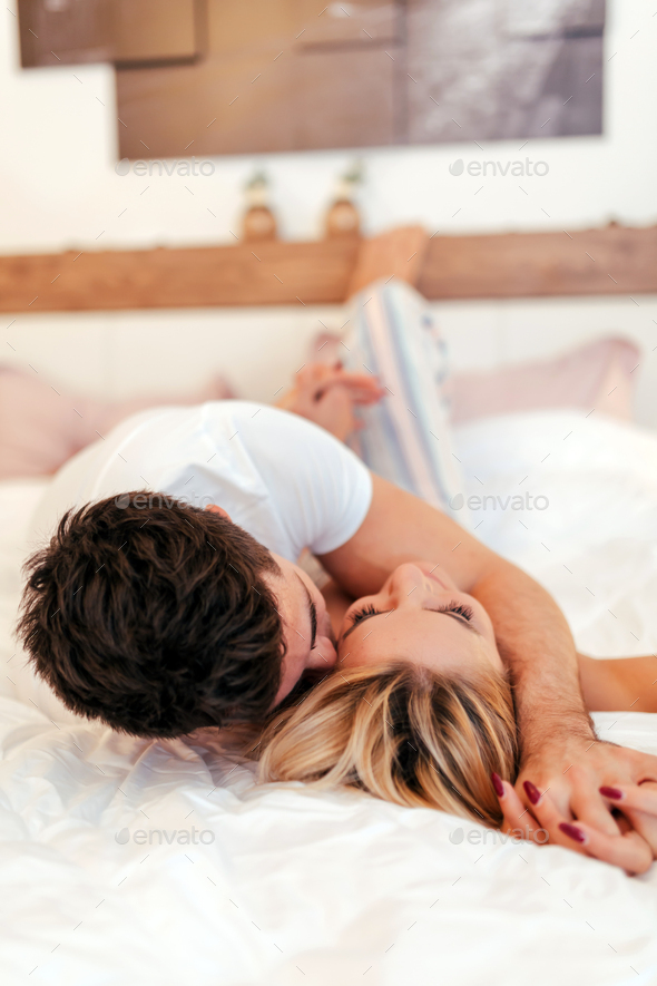 Happy couple in bedroom - Stock Photo - Images