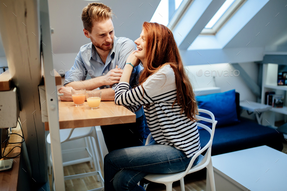 Happy couple bonding at home - Stock Photo - Images