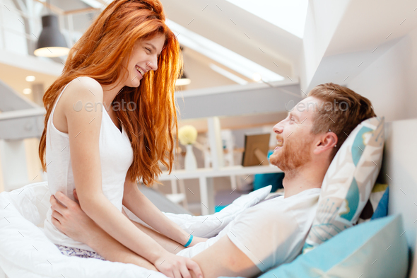 Passionate couple foreplay in bed - Stock Photo - Images