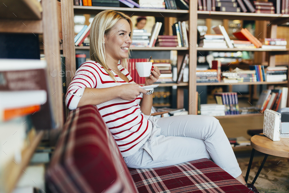 Beautiful woman relaxing after studying - Stock Photo - Images