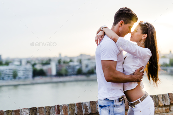 Young beautiful couple hugging and about to kiss - Stock Photo - Images