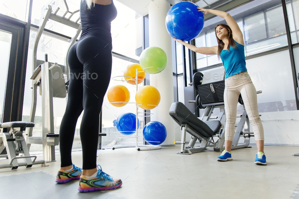 Women, friends training in gym and stretching - Stock Photo - Images