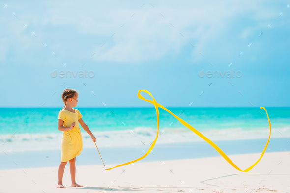 Adorable little girl at beach during summer vacation - Stock Photo - Images