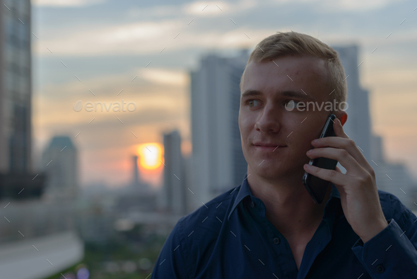 Portrait of young blond man outdoors - Stock Photo - Images