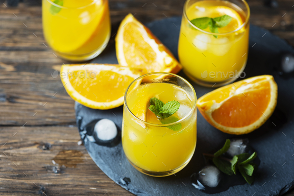 Fresh summer cocktail with orange and mint - Stock Photo - Images