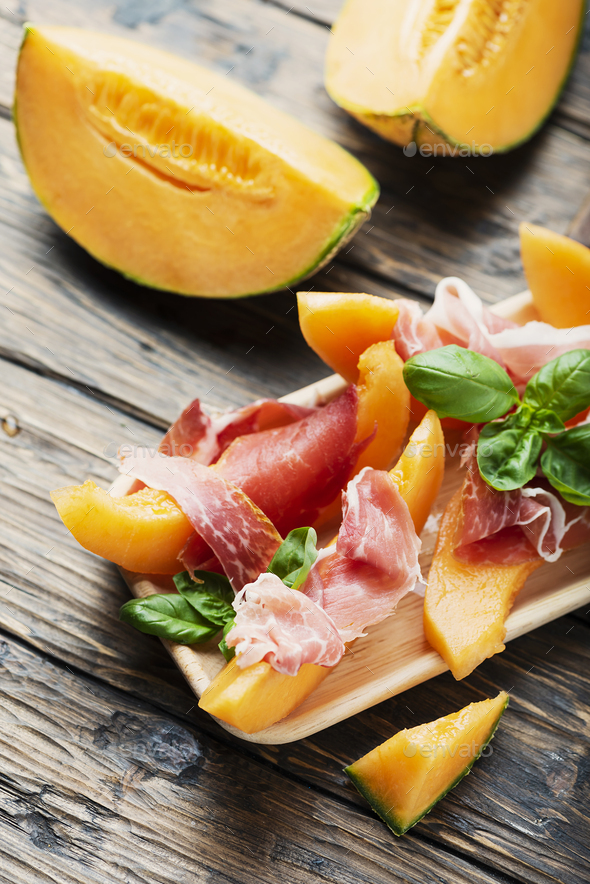 Italian antipasto with melon and ham - Stock Photo - Images
