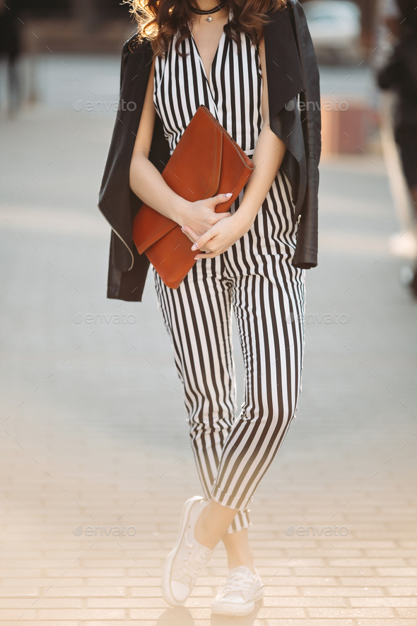 Stylish spring look with striped overalls and leather jacket - Stock Photo - Images