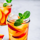 Homemade peach iced tea or lemonade with fresh mint and ice cubes in glass jar - PhotoDune Item for Sale