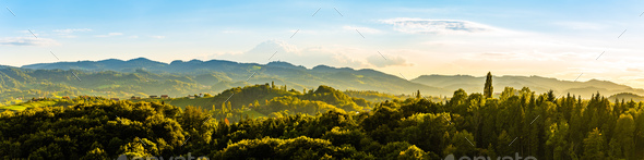 Panoramic view from vineyard to green hills of south styrian wine route in Austria in sunset. Glanz - Stock Photo - Images