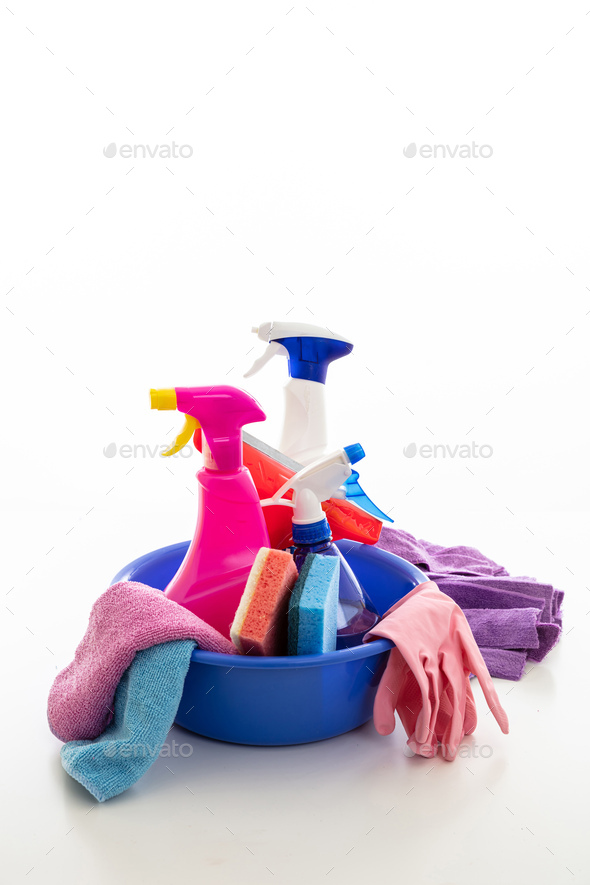 Cleaning supplies in a blue bowl isolated against white background. - Stock Photo - Images