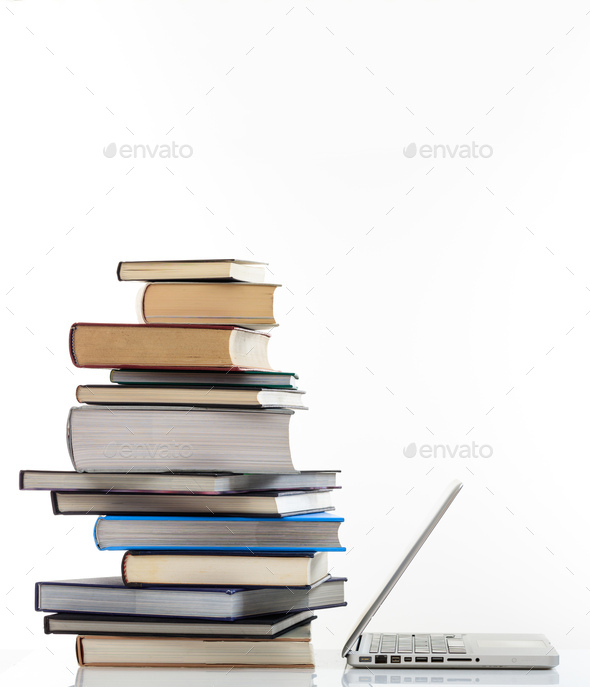 Elearning, books stack and a laptop isolated on white background - Stock Photo - Images