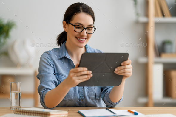 woman is using tablet pc for remote conversation - Stock Photo - Images
